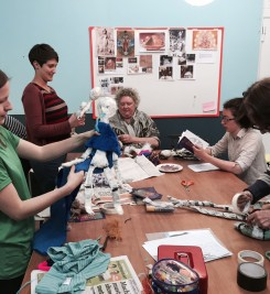Tessa leading a puppetry workshop at a women's circle in Bristol.